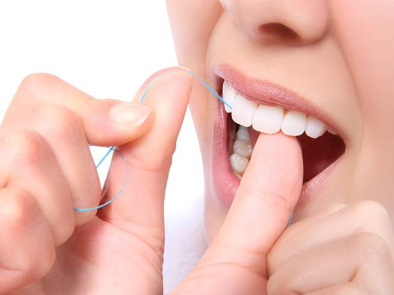 آموزش استفاده صحیح از نخ دندان